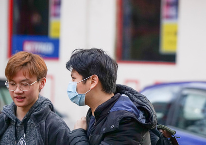 A man wears a face mask as a precaution to the outbreak of Coronavirus in Central Manchester. Two people in the same family have been diagnosed with the Coronavirus in the UK.