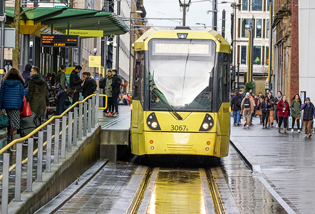A Tram is seen stopped at St Anne Square in Manchester.