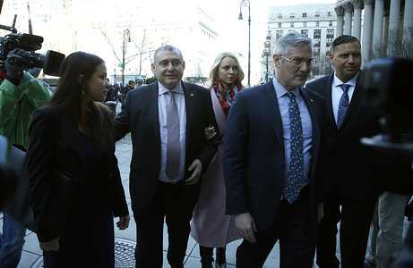 "Lev Parnas (L) and his wife Svetalna Parnas (R) are seen entering the Thurgood Marshall United States Court House. Parnas was indicted on campaign charges following his involvement in funneling foreign money into U.S. campaigns. He and his business partner Igor Fruman were complicit in digging up""dirt"" on U.S. ambassador to the Ukraine, Marie Yovanovitch as part of a compensatory action for then Ukrainian President Volodymyr Zelensky who's relationship with Yovanovitch was strained."