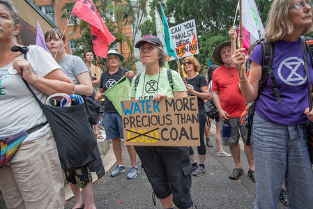Protesters hold placards and flags during the demonstration. Extinction Rebellion activists march and take actions in front of the Queensland Parliament in Brisbane. Rallies and civil disobedience held across Australia and around the world to demand for urgent actions on environmental issues.