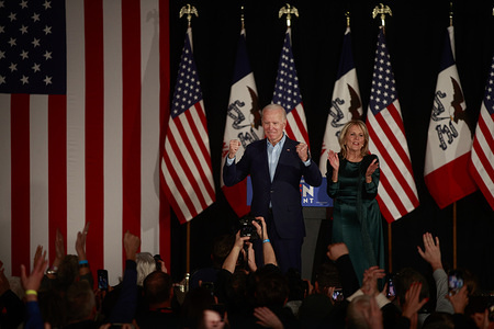 Democratic presidential candidate, Joe Biden, with his wife, Jill Biden at his side addresses a crowd of supporters and the media on caucus night at Drake University. The results of the Iowa Caucuses were delayed but Biden spoke to the crowd gathered.