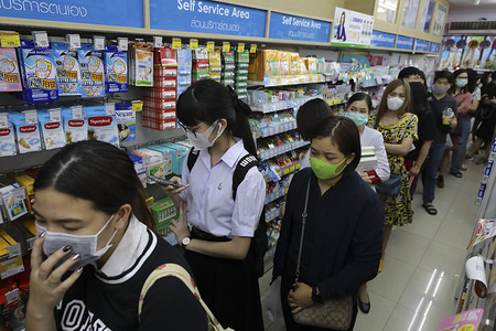 People queue at a pharmacy to buy face masks at Siam square, following the outbreak. Bangkok is facing a shortage of protective surgical masks. The coronavirus originating from Wuhan China has spread across Asia causing panic in multiple countries inducing Thailand. Thailand has detected 25 cases. The virus has so far killed at least 425 people with over 20627 confirmed cases worldwide.