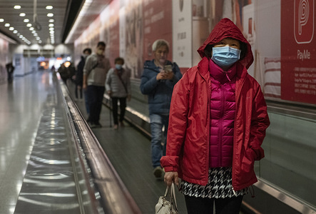 HONG KONG, CHINA - FEBRUARY 4, 2020: Commuters wearing face masks seen in MTR subway station in Hong Kong. Hong Kong on February 4 became the second place outside mainland China to report the death of a coronavirus patient as officials said they feared local transmissions were increasing in the densely populated city.