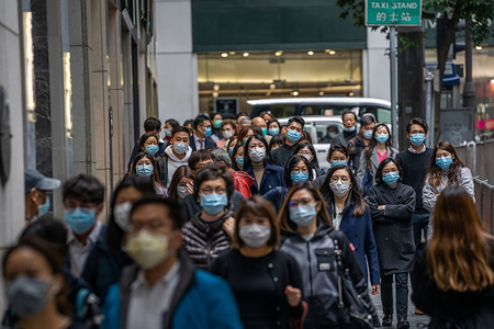 People wearing surgical masks in central district of Hong Kong as a preventative measure following the Coronavirus outbreak which began in the Chinese city of Wuhan. Hong Kong on February 4 became the second place outside mainland China to report the death of a coronavirus patient as officials said they feared local transmissions were increasing in the densely populated city.