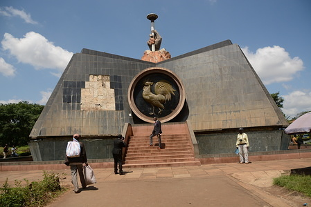 People walk past the nyayo monument at central park in Nairobi, It was built in 1988 during the late Daniel Arap Moi's regime to commemorate 25 years of independence. Former President of Kenya, Daniel Arap Moi died aged 95 while undergoing treatment at the Nairobi Hospital on February 4, 2020. He was president for 24 years from 1978 to 2002.