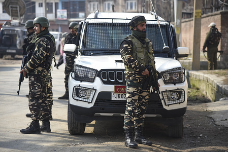 Indian paramilitary troopers stand on guard near the site of a grenade blast in Srinagar. At least one Indian paramilitary trooper injured after a grenade attack took place outside a police station in Lal bazar area of Srinagar Indian administered Kashmir.