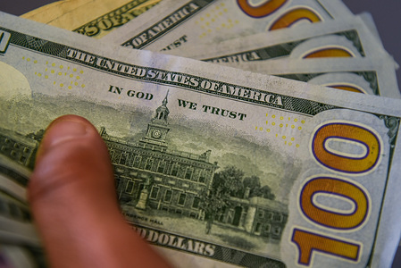 In this photo illustration 100 US dollar banknotes seen displayed.