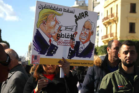 Images of Donald Trump and Benjamin Netanyahu on a placard during a protest staged against U.S. President, Donald Trump's Middle East peace plan in front of Municipality Theatre.