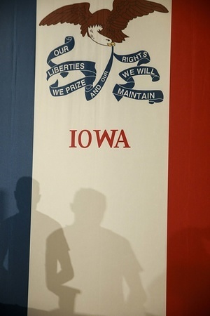 A worker takes down an American flag after the Democratic presidential candidate Joe Biden, with his wife Jill Biden at his side, spoke to a crowd of supporters and the media on a caucus night in Des Moines.  The Iowa Caucuses were held February 3, 2020, but the results were delayed as chaos ensued during the count.