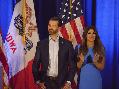 Members of United States President Donald J. Trump's family including, left to right, Donald Trump Jr, Trump Junior's girlfriend, Kim Guilfoyle attend the Keep Iowa Great press conference in Des Moines.