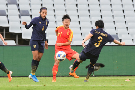 Pikul Khueanpet (L), Zhang Linyan (C) and Natthakarn Chinwong (R) in action during the 2020 AFC Women's Olympic Qualifying Tournament match between Thailand and China at the Campbelltown Sports Stadium in Leumeah. Final score; Thailand 1:6 China.