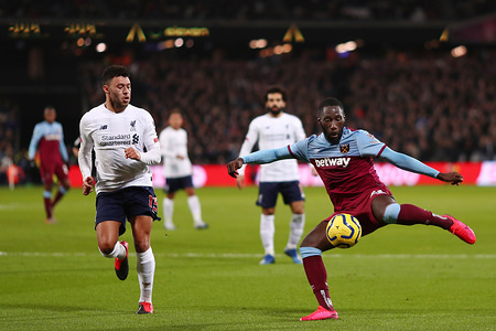 Arthur Masuaku of West Ham United and Alex Oxlade-Chamberlain of Liverpool in action during the Premier League match between West Ham United and Liverpool at London Stadium. (Final Score; West Ham United 0:2 Liverpool)