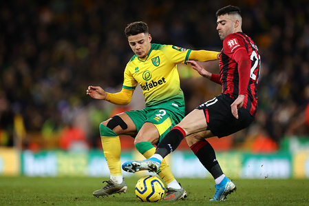 Max Aarons of Norwich City and Diego Rico of AFC Bournemouth in action during the Premier League match between Norwich City and AFC Bournemouth at Carrow Road. (Final Score; Norwich City 1:0 AFC Bournemouth)