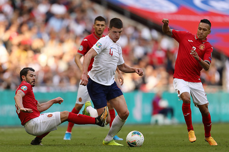 Declan Rice of England in action with Galin Ivanov (L) and Marcelinho (R) of Bulgaria during the UEFA Euro 2020 Group A Qualifier match between England and Bulgaria at Wembley Stadium. (Final Score; England 4 : 0 Bulgaria)