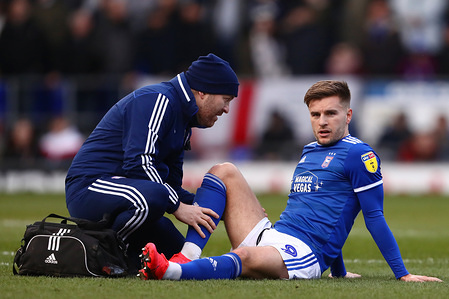 Luke Garbutt of Ipswich Town receives treatment before being substituted during the Sky Bet League One match between Ipswich Town and Peterborough United at Portman Road. (Final score; Ipswich Town 1:4 Peterborough United)