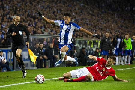 FC Porto's player Luiz Díaz (L) and SL Benfica's player Ferro (L) are seen in action during a football match for the Portuguese first league between FC Porto and SL Benfica at Dragon Stadium in Porto. (Final score; FC Porto 3:2 SL Benfica)