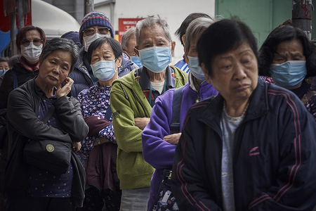 Hong Kong elderly queuing up for surgical masks giveaway in To Kwa Wan. Giveaway of surgical masks drew hundreds of elderly queuing up for hours under the fear of the deadly corona virus in Hong Kong.