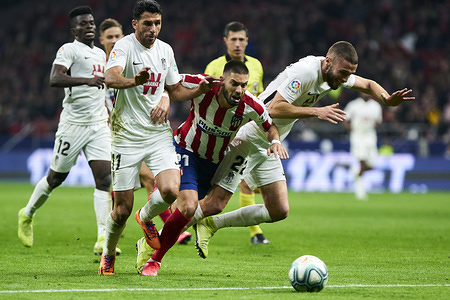 Nikola Kalinic (C), Ismail Koybasi (L) and Domingos Duarte (R) in action during the La Liga match between Atletico de Madrid and Granada CF at Wanda Metropolitano Stadium in Madrid. Final score; Atletico de Madrid 1:0 Granada CF.