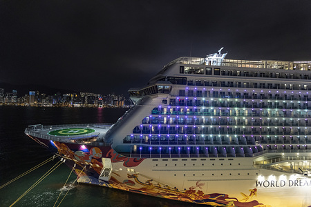 HONG KONG, CHINA, FEBRUARY 9, 2020: A view of a part of 151,000-tonne World Dream cruise ship during the disembarkation. Around 1,800 passengers have been allowed to disembark after completing a test with negative result for the 2019 Novel Corona virus (2019-nCoV). Thousands of people were quarantined for 5 days inside the 151,000-tonne World Dream cruise ship dock in Kai Tak cruise terminal, Hong Kong after being denied entering Taiwan as few passengers were found infected with coronavirus symptoms.