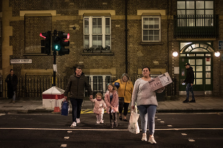 A family crosses the street.