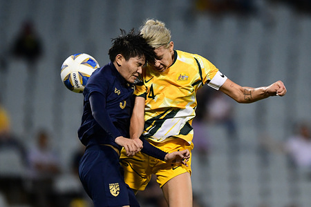 Natthakarn Chinwong (L) and Alanna Kennedy (R) are seen in action during the 2020 AFC Women's Olympic Qualifying Tournament match between Thailand and Australia at the Campbelltown Sports Stadium in Leumeah. (Final score; Australia 6:0 Thailand)