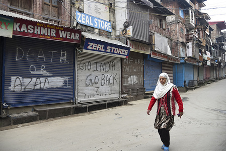 A Kashmiri woman walks in front of closed shops during the shutdown in Srinagar. Restrictions on movement of vehicles were imposed in some parts of Srinagar as Jammu Kashmir Liberation Front (JKLF), a separatist group in the Valley called for a strike to commemorate the death anniversary of JKLF founder Maqbool Bhat. Maqbool was hanged by Indian Government in New Delhi's Tihar Jail on February 11, 1984. JKLF's call for a strike and it's the first by any separatist group since August 5, 2019, when the BJP-led Central government revoked Article 370 of the constitution. Meanwhile internet services were also snapped in Kashmir valley.
