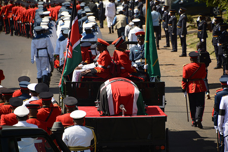 Kenyan military officers escort a carriage carrying a casket with a body of the late retired president of Kenya Daniel Arap Moi during a funeral procession to Nyayo Stadium in Nairobi.