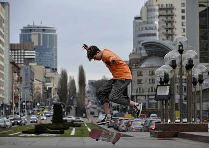 A teenager performs a trick on his skateboard in central Kiev. The temperature in the capital of Ukraine reached 4C (40F).