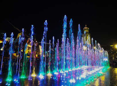 Different colours of light seen as the water rises upwards to the delight of spectators during the inauguration. The Musical Dancing Fountain lights up the Kartilla ng Katipunan Shrine in Manila during it's opening. In his address, Mayor Francisco Domagoso said that the city government of Manila has not released any funds for the construction of the fountain. It was with the help of a number of private companies that provided huge support to carry out the development and beautification of the Katipunan cartridge.