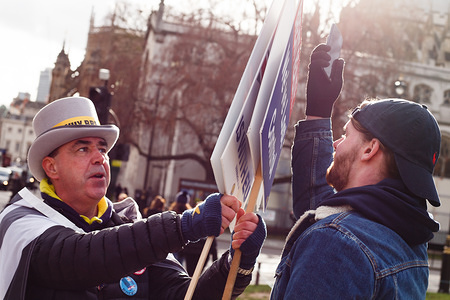 Anti-Brexit activist, Steve Bray fends off provocations by a Brexit supporter outside the Houses of Parliament in London.