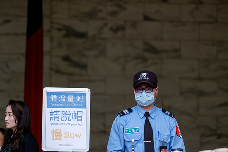 Security guard wearing a surgical mask during the guard changing ceremony at Chiang Kai Shek Memorial Hall following the corona virus threat. While the world is struggling with more than 60000 confirmed cases of the Corona virus disease 2019 / COVID-19 (with 99% of the cases in China), the WHO is still playing deaf to calls from officials around the world in favor of the inclusion of Taiwan to the discussions.