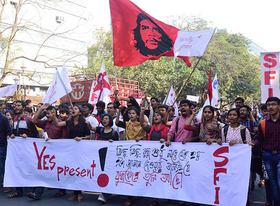 Jawaharlal Nehru University students march while holding a banner and chanting slogans during the rally in support of SFI candidates for upcoming elections in Jadavpur University in Kolkata.