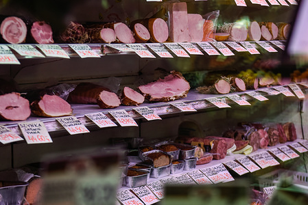 Several kinds of smoked pork hams for sale at the market. Nowy Klepasz is one of the many outdoor markets, where food products, clothes, groceries among other things are bought from micro traders.
