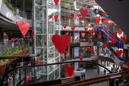 KATHMANDU, NEPAL, FEBRUARY 14, 2020: People at a shopping mall decorated with red heart shapes during Valentine's Day. Shopping malls are always decorated on such kind of events to attract youths.