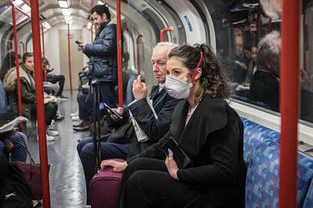 A woman seen on a tube wearing a face mask.  A total of nine people in the UK are now being treated for COVID-19, the disease caused by the coronavirus. Doctors have warned that the London Underground could be a hotbed for the coronavirus.