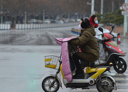 Cyclists ride electric bikes while wearing surgical masks amid coronavirus fears. Coronavirus (COVID-19) has killed more than 1,500 people in China and infected more than 66,000 people.