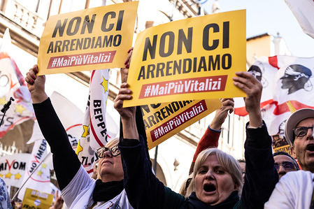 Supporters hold placards as they take part during the demonstration. A national demonstration called by the 5-star movement (M5S) to defend a recent law that cut parliamentary pensions took place in Rome.
