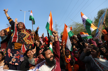 Protesters chant slogans while making gestures during the demonstrations against the new Citizenship Amendment Act 2019 at Shaheen bagh in New Delhi.