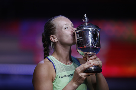 Kiki Bertens of Netherlands poses for a photo with a trophy after winning a final match of the St.Petersburg Ladies Trophy 2020 tennis tournament at Sibur Arena.