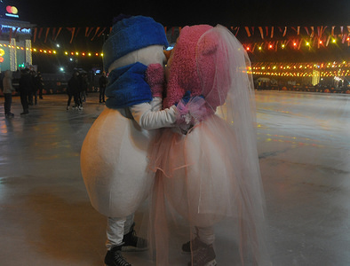 """A couple seen kissing on Valentine's Day in Kiev, a record was set for """"The most popular kiss on the rink''."""