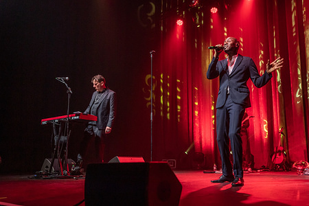 DUBLIN, IRELAND - FEBRUARY 16. 2020: 90's Band Lighthouse Family duo Vocalist Tunde Baiyewu and Piano player Paul Tucker perform live on stage at Olympia Theatre in Dublin.