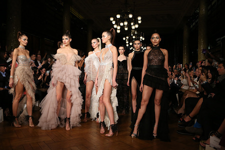 LONDON, UNITED KINGDOM - 17 FEBRUARY 2020: Models walk the runway at the Autumn / Winter 2020 AADNEVIK Fashion Show during the London Fashion Week Women's at the The Royal Horseguards, One Whitehall Place in London.