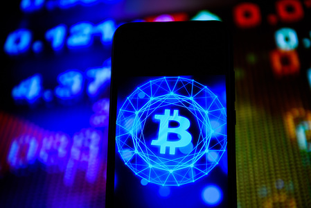 In this photo illustration a Bitcoin logo  seen displayed on a smartphone.