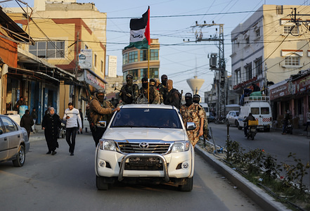 """Palestinian activists from the Nasser Salah El-Din Brigade take part during an anti-Israel demonstration in Khan Yunis. Al-Nasser Salah Al-Din Brigades hold an anti-Israel military parade, southern Gaza Strip as part of the second anniversary of an operation called """"Ambush Al-Alam carried out in Khan Yunis."""