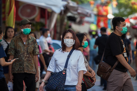 People wearing face masks close to a Chinese temple in Bugis, following the corona virus threat. Singapore declared the COVID-19 outbreak as Code Orange on February 7, 2020.