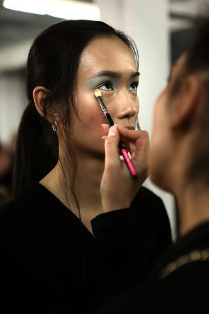 A model backstage getting ready for the University of Westminster show during London Fashion Week.