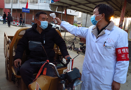 Village workers measured the temperature of travellers at an epidemic prevention and control checkpoint in Luzhai Town, Linquan County, Anhui Province which is one of the high-risk areas for COVID-19. On February 20, 2020, COVID-19 coronavirus killed more than 2,100 people in China and infected more than 74,000 people.