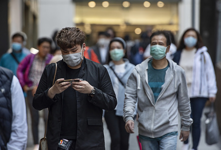 Pedestrians wearing face masks as a preventive measure against the Coronavirus, official name covid-19, seen in Central district in Hong Kong.