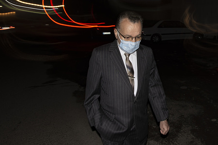 A man wearing a face mask as a precaution against the outbreak of Coronavirus walks on the street. With the spread of coronavirus in the world, the virus has hit Iran and Qom, Rasht has the highest number of people with coronavirus in Iran. Currently schools and universities in Gilan province are closed and people move less in the city.