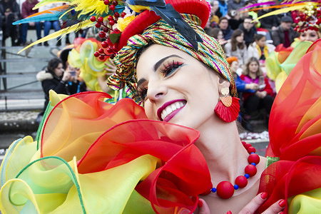 A dancer performs during the carnival. Carnival parade in Ovar is one of the most well-known carnivals in Portugal, with several revellers and samba groups.
